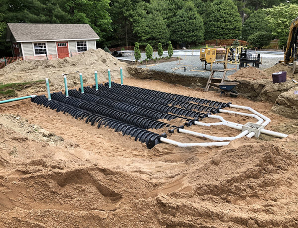 This Is A Photo Of A Newly Installed Drainage System In A Backyard In Southwick